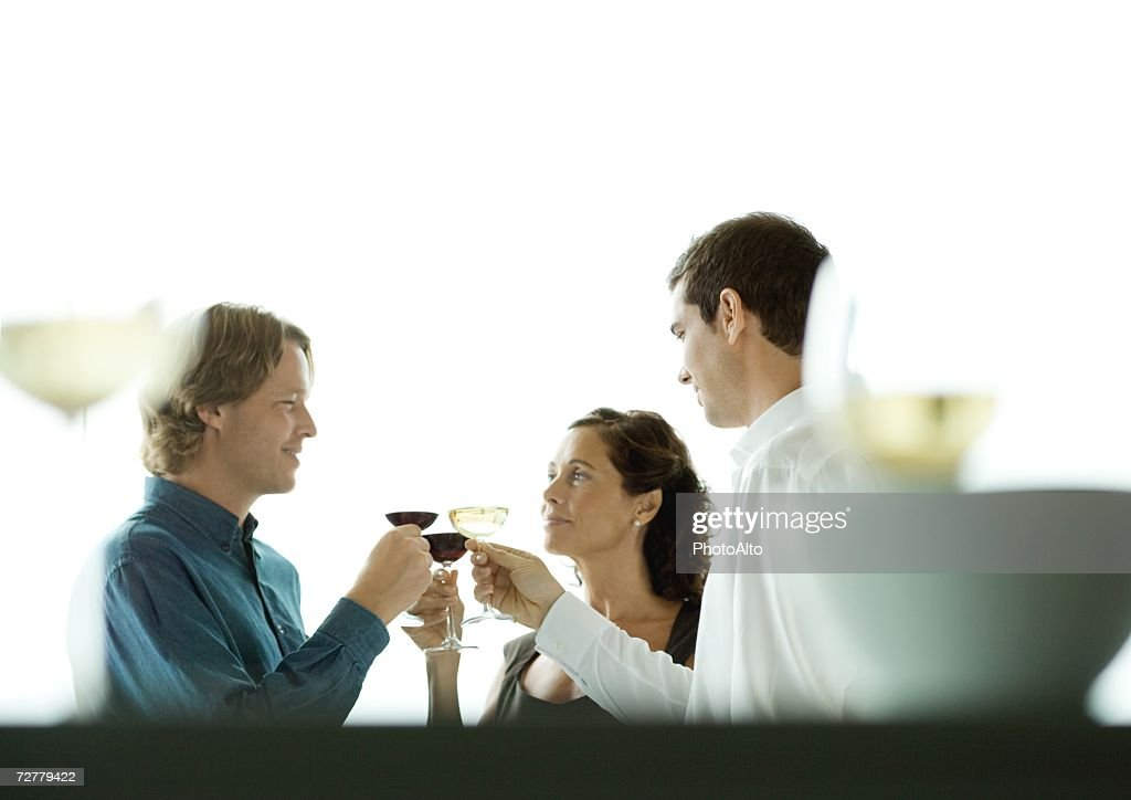 People making a toast with glasses of wine : Stock Photo