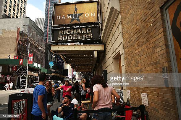 People many who have been there for days wait in line with dozens of others for tickets for the popular Broadway show Hamilton on June 21 2016 in New...