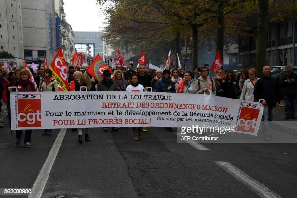People march a demonstration called by the CGT workers' union against the French president's labour law reforms on October 19 2017 in Rennes...
