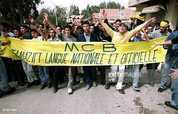 People march and chant slogans 19 April 2001 during a demonstration organised by the Berber cultural movement in the regional capital of Kabylia Tizi...