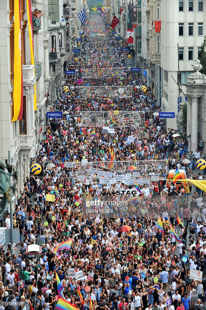 People march and chant slogans during a gay parade on Istiklal Street, the main shopping corridor on June 30, 2013 in Istanbul during the fourth Trans Pride Parade as part of the Trans Pride Week 2013, which is organized by Istanbul's 'Lesbians, Gays, Bisexuals, Transvestites and Transsexuals' (LGBTT) solidarity organization. AFP PHOTO/OZAN KOSE