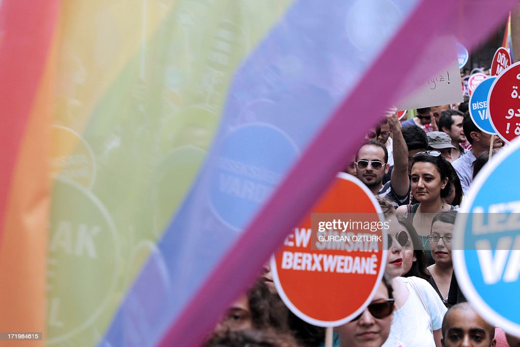 People march and chant slogans during a gay parade on Istiklal Street, the main shopping corridor on June 30, 2013 in Istanbul during the fourth Trans Pride Parade as part of the Trans Pride Week 2013, which is organized by Istanbul's 'Lesbians, Gays, Bisexuals, Transvestites and Transsexuals' (LGBTT) solidarity organization. AFP PHOTO/GURCAN OZTURK