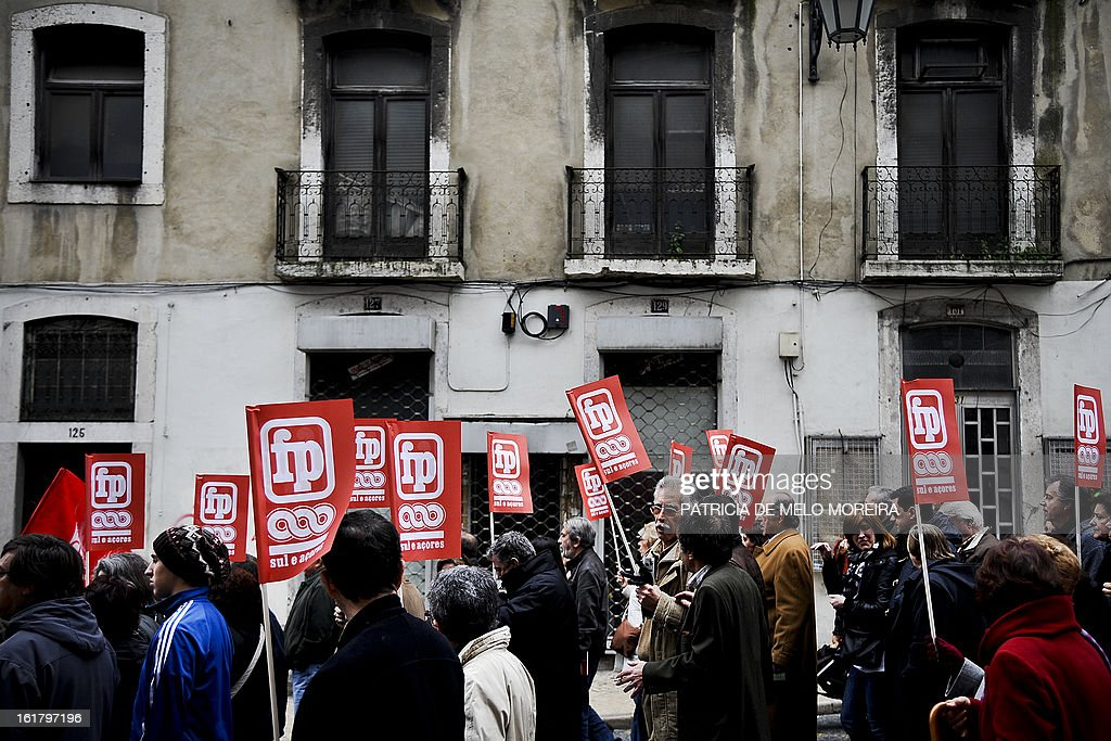 People march and hold flags during a demonstration organized by Portugal's biggest trade union CGTP (Portuguese General Workers Confederation) against government austerity measures in Lisbon, on February 16, 2013. AFP PHOTO/ PATRICIA DE MELO MOREIRA
