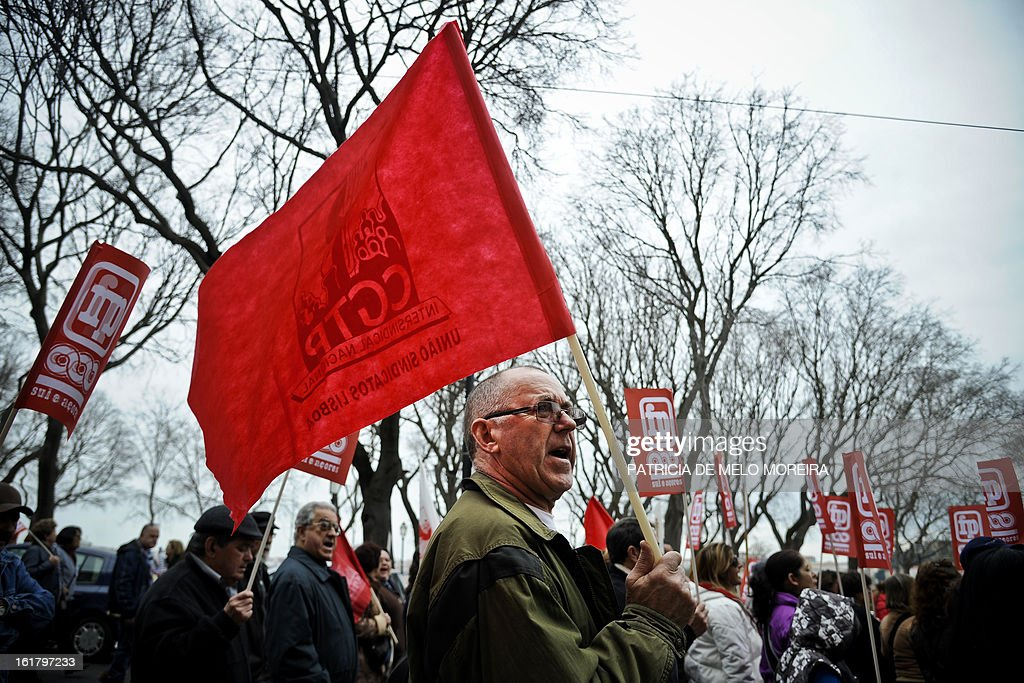People march and hold flags during a demonstration organized by Portugal's biggest trade union CGTP (Portuguese General Workers Confederation) against government austerity measures in Lisbon, on February 16, 2013.