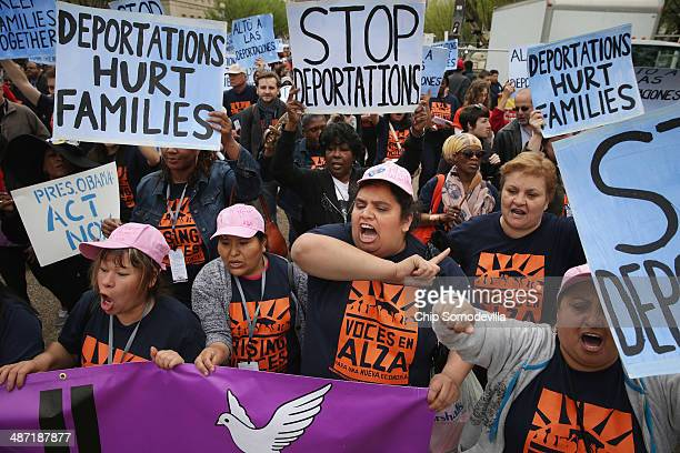 People march and rally in front of the White House to demonstrate against President Barack Obama's immigration and deportation actions April 28 2014...