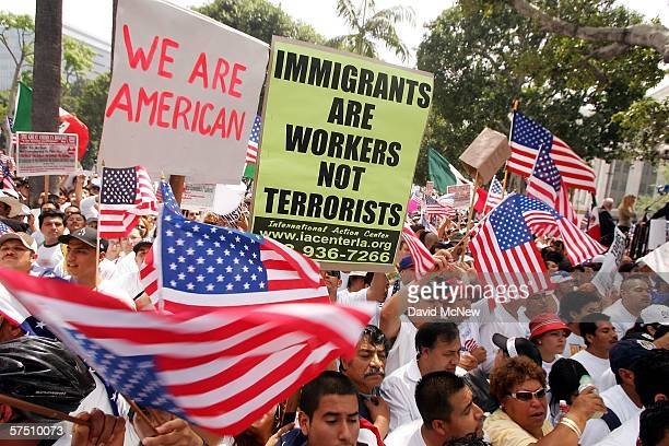 People march and rally on what is being dubbed a 'Day Without Immigrants' or the 'Great American Boycott' day on May 1 2006 in Los Angeles California...