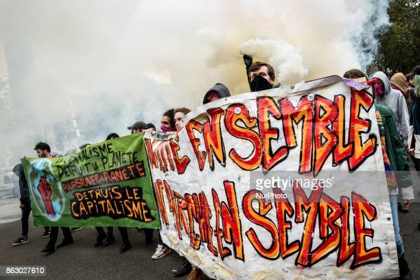 People march behind a banner as thousands gather in the streets of Lyon France to protest against the labor law at the call of the CGT the UNEF and...