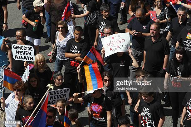 People march down Hollywood Boulevard on the 99th anniversary of the Armenian Genocide calling for recognition and reparations on April 24 2014 in...