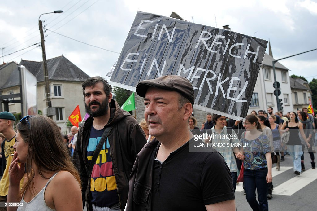 People march during a demonstration against controversial labour reforms, on June 28, 2016 in Rennes. Unions have called repeated strikes and marches in opposition to the law, which seeks to bring down France's intractable 10-percent unemployment rate by making it easier to hire and fire workers.