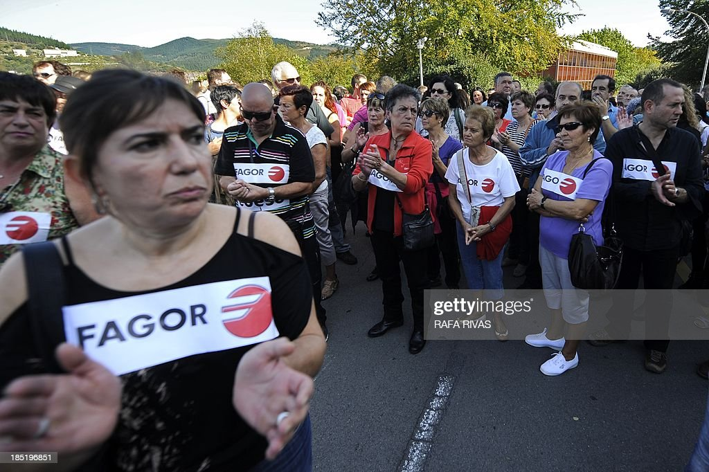 People march during a demonstration called by workers of Spanish electrical appliance maker Fagor which has filed for protection from creditors, on October 18, 2013, in the northern Spanish Basque town of Mondragon. The maker of everything from small appliances to washing machines, fridges and kitchen furniture said it had started negotiations to restructure its debt, estimated by the Spanish media at 800 million euros ($1.1 billion). AFP PHOTO / RAFA RIVAS