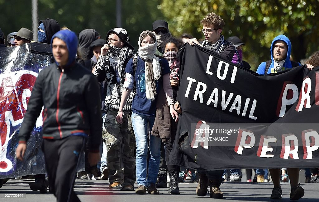 People march during a protest against the government's planned labour law reforms in Nantes, western France, on May 3, 2016. High school pupils and workers protested against deeply unpopular labour reforms that have divided the Socialist government and raised hackles in a country accustomed to iron-clad job security. / AFP / LOIC