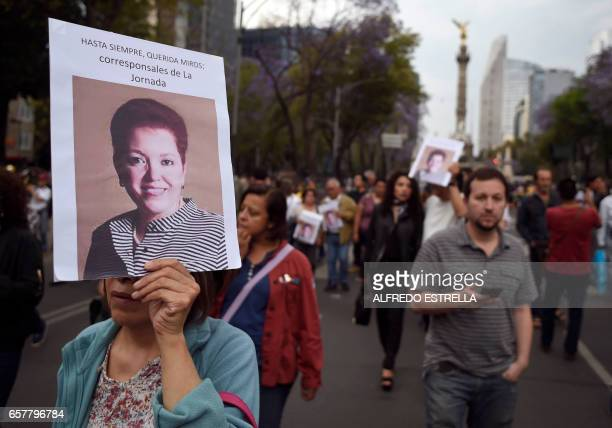 People march during a protest against the recent murder of the correspondent journalist Miroslava Breach of La Jornada newspaper at the Angel de la...