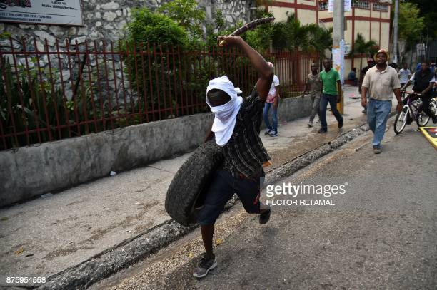 People march during a protest against the remobilisation of the army and angry at a senatorial report that investigated the Petrocaribe funds between...