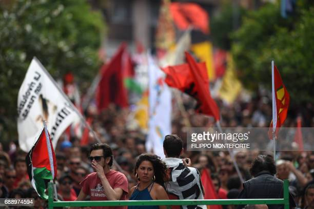 People march during a rally against the G7 Summit in GiardiniNaxos near the venue of the G7 summit of Heads of State and of Government in Taormina on...