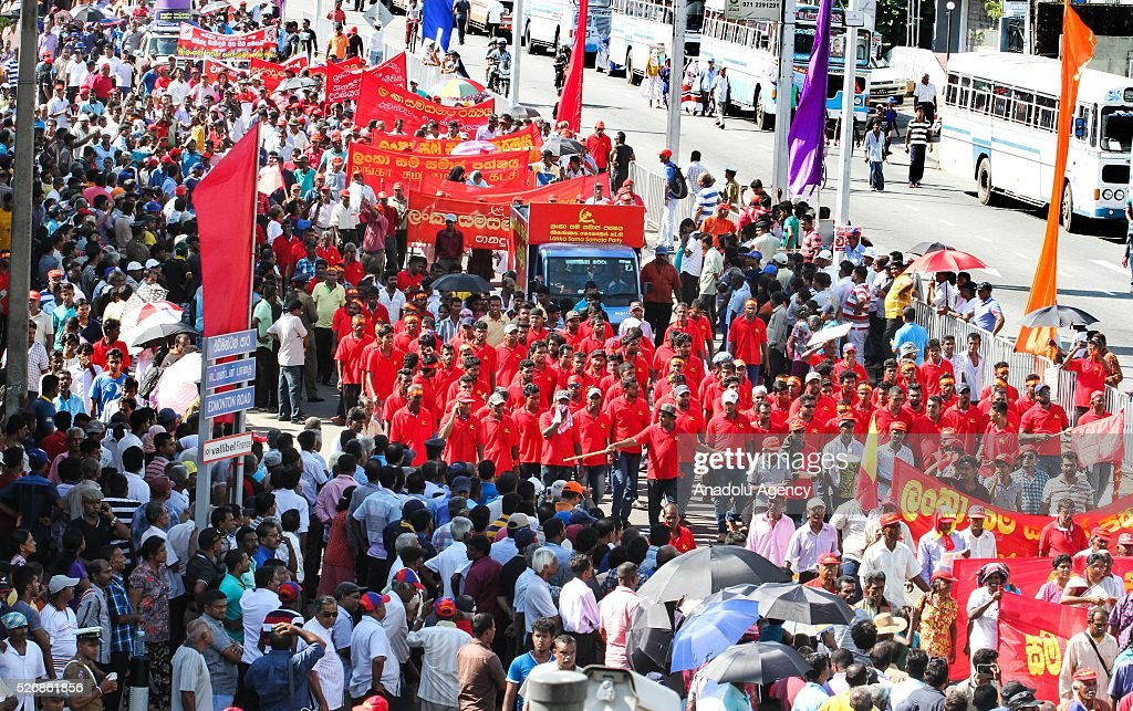 People march during a rally to mark International Labor Day in Colombo, on May 1, 2016.