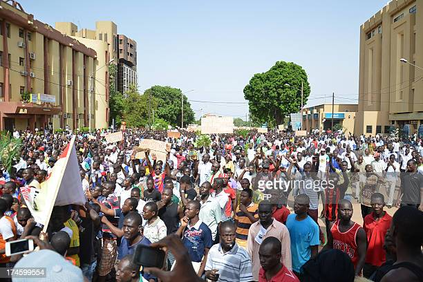 People march during an opposition protest in Ouagadougou on July 28 2013 against the creation of a Senate which they say will enable the President to...