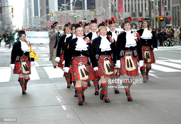 People march during the 'Tunes Of Glory' Parade celebrating 'Tartan Day' on Sixth Ave April 5 2003 in New York City Twothousand bagpipers were...