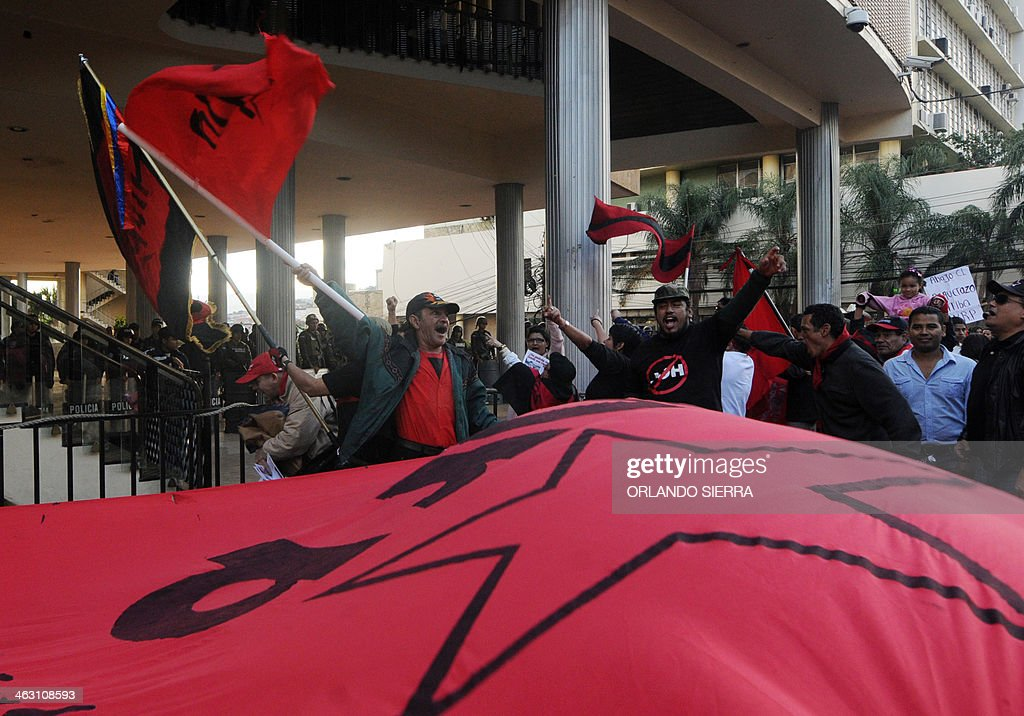 People march from the Obelisc to the Congress in downtown Tegucigalpa to protest against a tax raise approved by the Congress on January 16 2014 AFP...