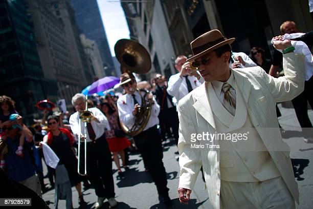 People march in a New Orleansstyle second line parade up Fifth Avenue to honor legendary Lindy Hop dancer Frankie Manning May 22 2009 in New York...