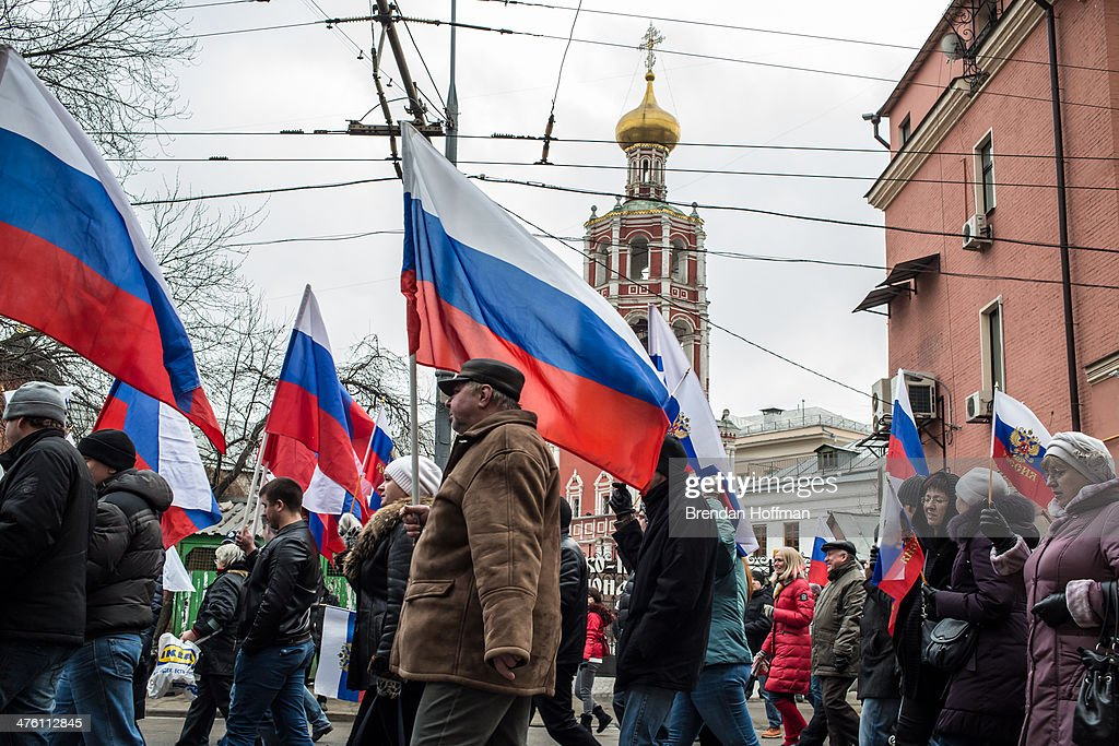 People march in a pro-government demonstration on March 2, 2014 in Moscow, Russia. After Ukraine's president Viktor Yanukovych was ousted last week following months of protests, Russia's military moved to protect what is seen as its interests in Crimea and eastern Ukraine, which have strong ties to Russia.