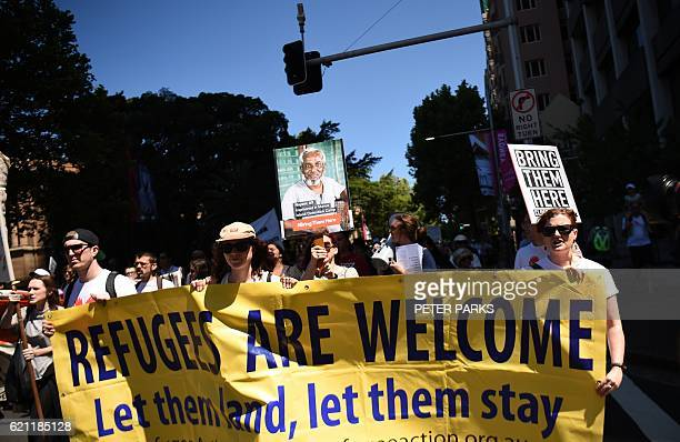 People march in an event organised by Doctors for Refugees to demand humane treatment of asylum seekers and refugees in Sydney on November 5 2016...