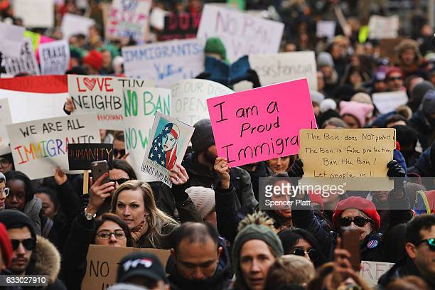 People march in lower Manhattan to protest US President Donald Trump's new immigration policies on January 29 2017 in New York City Trump's executive...