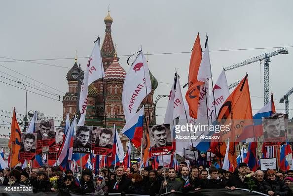 People march in memory of Russian opposition leader and former Deputy Prime Minister Boris Nemtsov on March 01 2015 in central Moscow Russia Nemtsov...