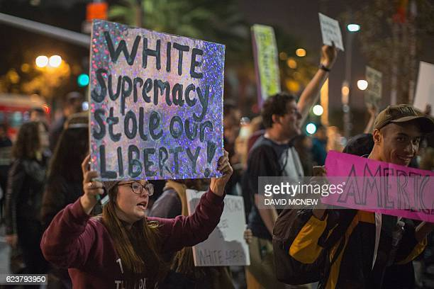 People march in protest to the appointment of white nationalist altright media mogul former Breitbart News head Steve Bannon to be chief strategist...