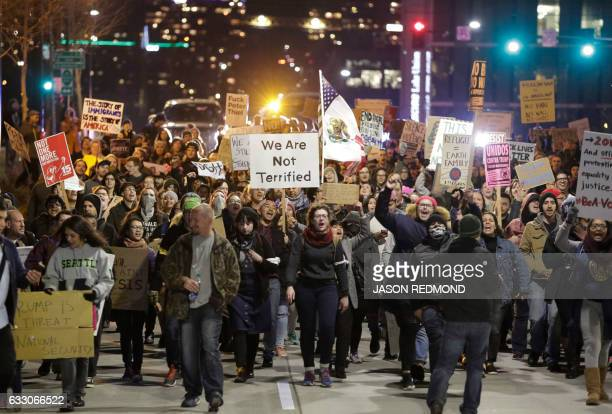 TOPSHOT People march in support of immigrants and refugees in Seattle Washington on January 29 2017 US President Trump signed the controversial...