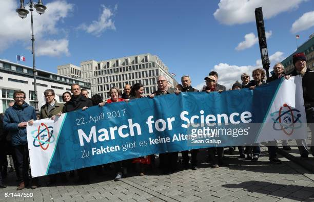 People march in support of scientific research during the 'March for Science' demonstration on April 22 2017 in Berlin Germany People all over the...