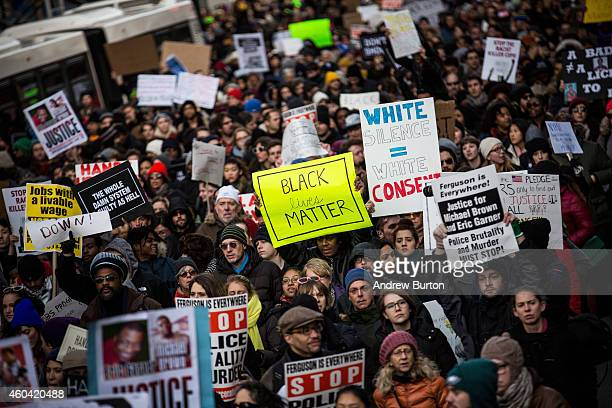 People march in the National March Against Police Violence which was organized by National Action Network through the streets of Manhattan on...