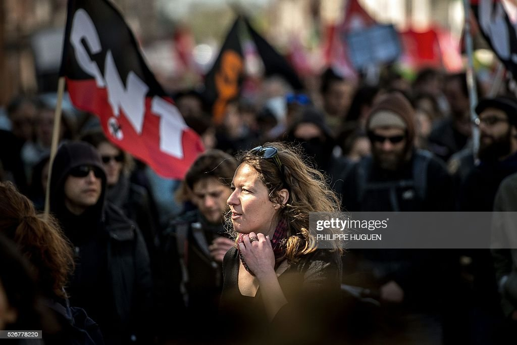 People march in the streets of Lille during a May Day rally on May 1, 2016. / AFP / PHILIPPE