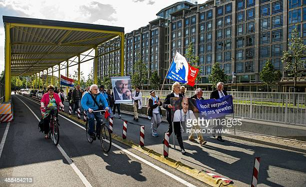 People march on May 6 2014 in Rotterdam in remembrance of slain farright Dutch politician Pim Fortuyn 12 years after he died on May 6 2002 The man...