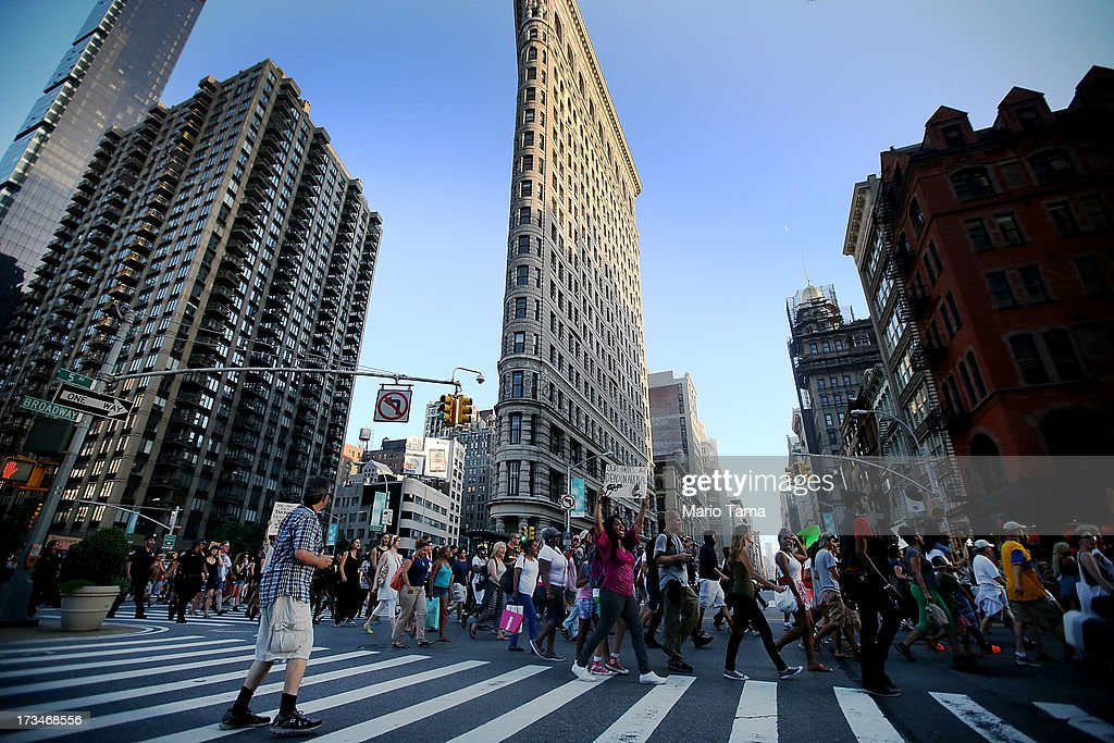 People march past the Flatiron Building while blocking traffic after a rally for Trayvon Martin in Union Square in Manhattan on July 14, 2013 in New York City. Many of the marchers made their way to Times Square where they were able to shut down traffic with a rally. George Zimmerman was acquitted of all charges in the shooting death of Martin July 13 and many protesters questioned the verdict.
