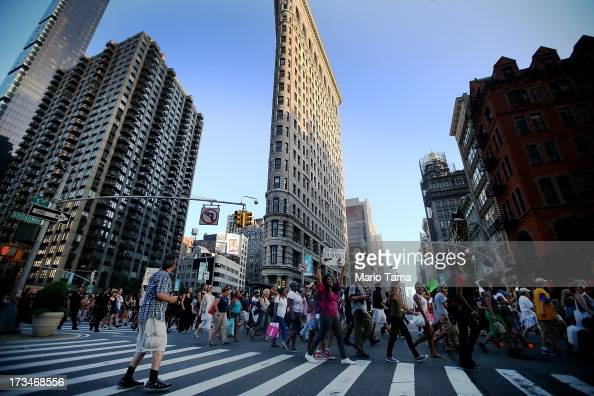 People march past the Flatiron Building while blocking traffic after a rally for Trayvon Martin in Union Square in Manhattan on July 14 2013 in New...