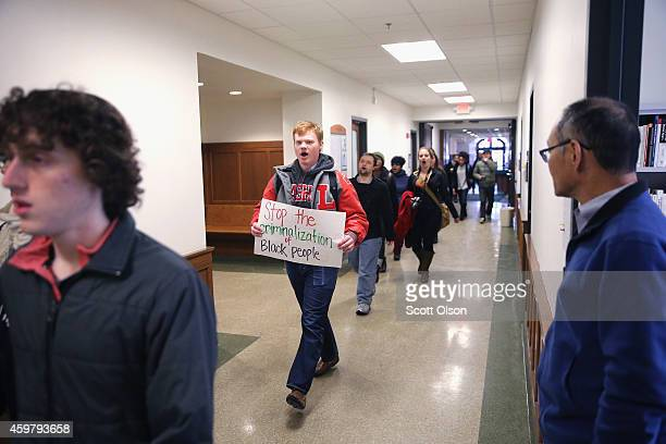 People march through a campus building during a protest at Washington University to draw attention to police abuse on December 1 2014 in St Louis...