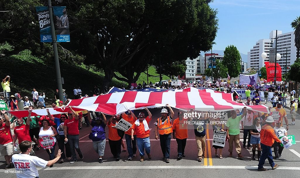 People march through downtown Los Angeles supporting immigrant rights during a May Day march on May 1 2014 in Los Angeles California Thousands...