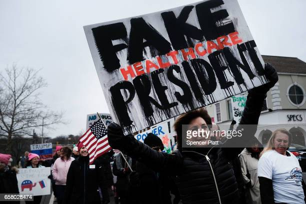 People march to protest against the policies and presidency of Donald Trump on March 26 2017 in Westport Connecticut Over 2000 people marched through...
