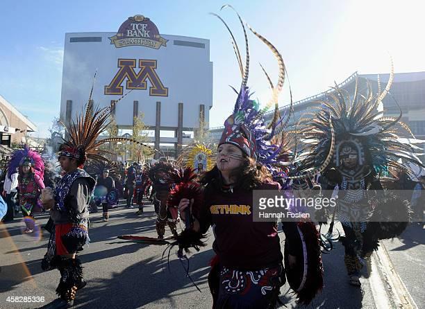 People march to TCF Bank Stadium to protest against the mascot for the Washington Redskins before the game against the Minnesota Vikings on November...