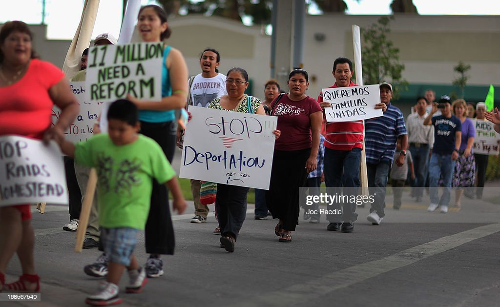 People march together during a rally calling on President Barack Obama to immediately suspend deportations and for Congress to pass an immigration reform that's inclusive of all 11 million undocumented people in the U.S. on May 11, 2013 in Homestead, Florida. The rally is part of what is being called a rolling fast in different places throughout the nation over the course of the next two months to bring what organizers say is a moral, prophetic voice to the immigration debate.