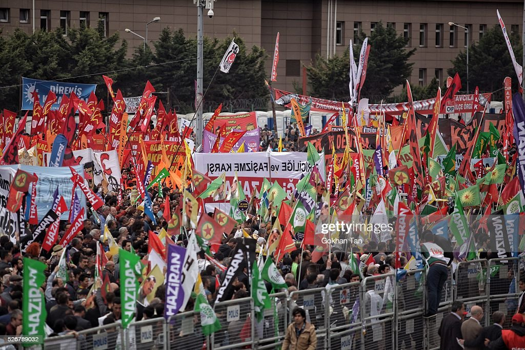 People march with flags in Istanbul's Bakirkoy district to celebrate May Day on May 1, 2016 in Istanbul, Turkey. Turkish police used tear gas and water cannon to disperse protesters as they tried to make their way to Taksim Square and other protest points.