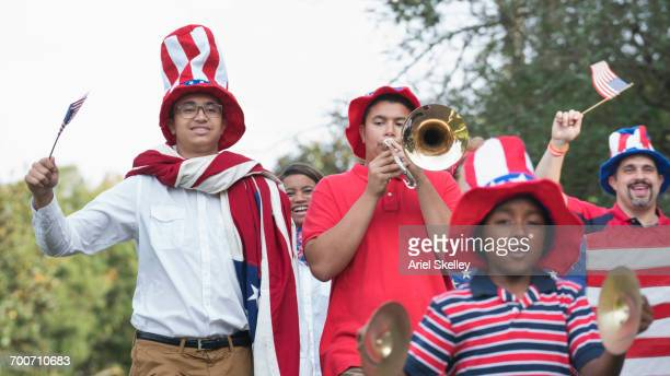 People marching in 4th of July parade in park