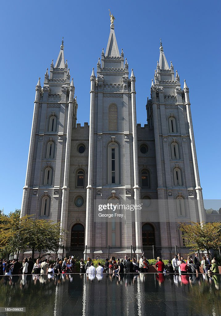 People mill around the Mormon temple on Temple Square during the 183rd Semi-Annual General Conference of the Church of Jesus Christ of Latter-Day Saints in Salt Lake City, Utah on October 6, 2013.