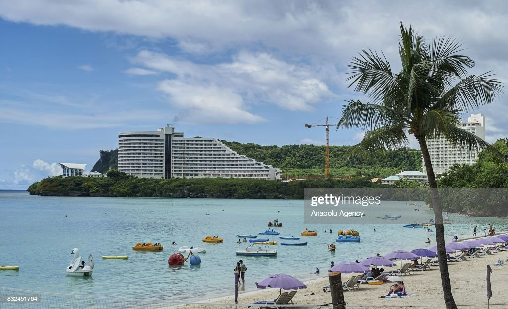 People, mostly include tourists, enjoy the sun, sea and the beach on Tumon Bay in Tumon, Guam on August 16, 2017. With the threat of missiles from North Korea the number of tourists have dropped slightly, and while the rest of the world is uneasy, island residents continue on with their daily lives.