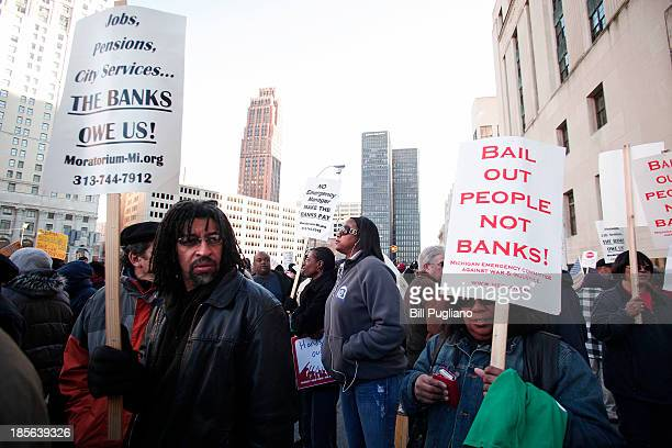 People mostly union and retired city workers protest in front of the US Courthouse where Detroit's bankruptcy eligibility trial began this morning...