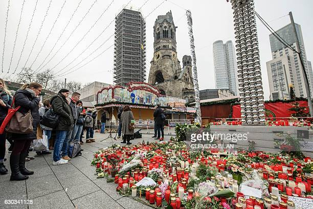 People mourn at a makeshift memorial with flowers and candles in front of the KaiserWilhelmGedaechtniskirche two days after the truck attack at the...