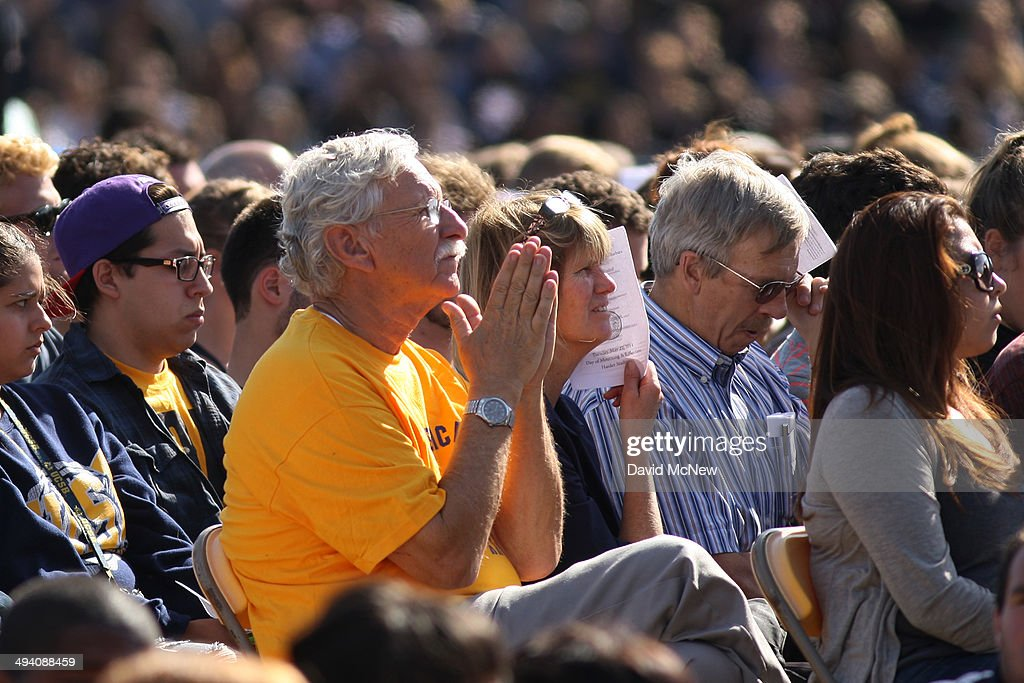 People mourn at a public memorial service on the Day of Mourning and Reflection for the victims of a killing spree at University of California, Santa Barbara on May 27, 2014 in Isla Vista, California. Elliot Rodger killed six college students at the start of Memorial Day weekend and wounded seven other people, stabbing three then shooting and running people down in his BMW near UCSB before shooting himself in the head as he drove. Police officers found three legally-purchased guns registered to him inside the vehicle. Prior to the murders, Rodger posted YouTube videos declaring his intention to annihilate the girls who rejected him sexually and others in retaliation for his remaining a virgin at age 22.
