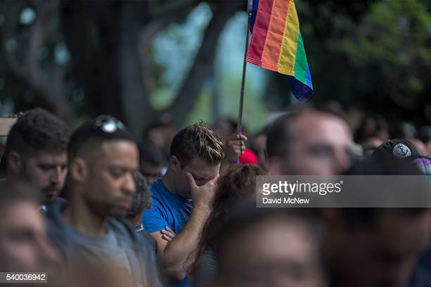 People mourn at a vigil for the worst mass shooing in United States history on June 13 2016 in Los Angeles United States A gunman killed 49 people...