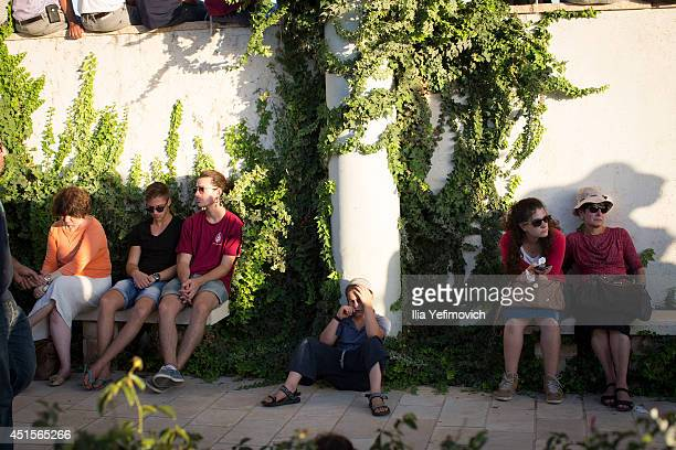 People mourn during the funeral ceremony held for the three Israeli teenagers found dead on July 1 2014 in Modiin Israel The bodies of Eyal Yifrah...
