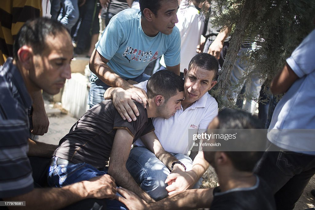 People mourn during the funeral held for three Palestinians killed during IDF operation at Kalandia refugee camp on August 26, 2013 in Ramallah, West Bank. At least 15 people were injured as Palestinians clash with undercover Israeli troops.